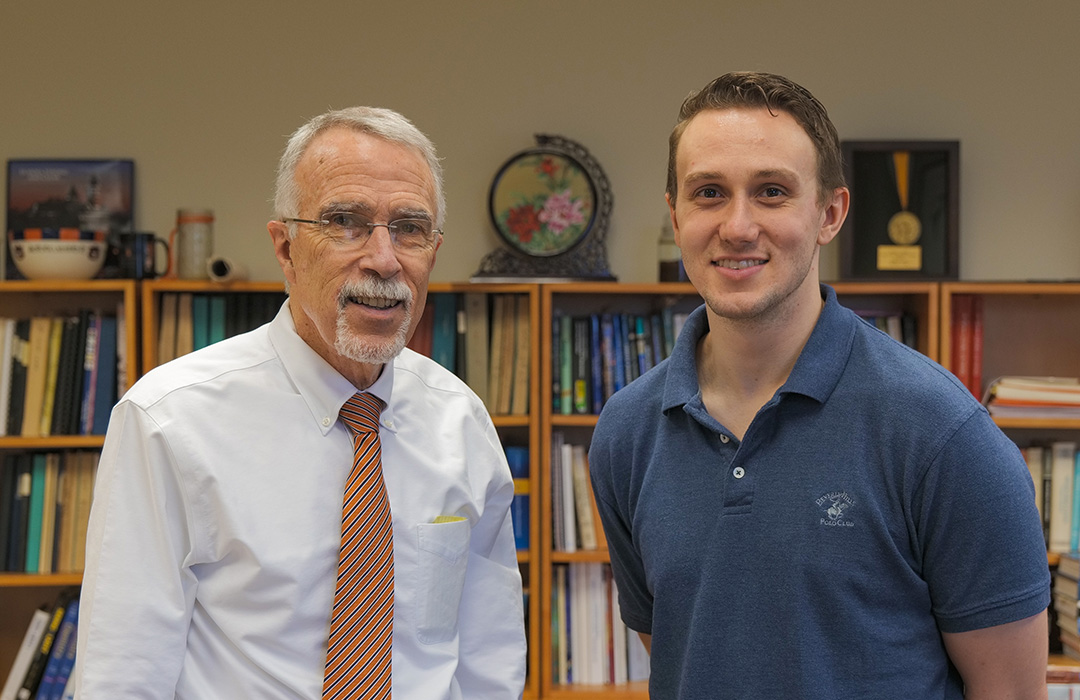 Dean Giordano and Jared Thacker, a doctoral student in the Department of Physics.