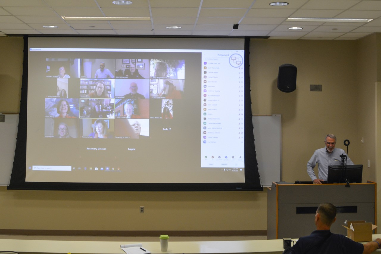 Dean Giordano presenting at Leadership Council in a classroom