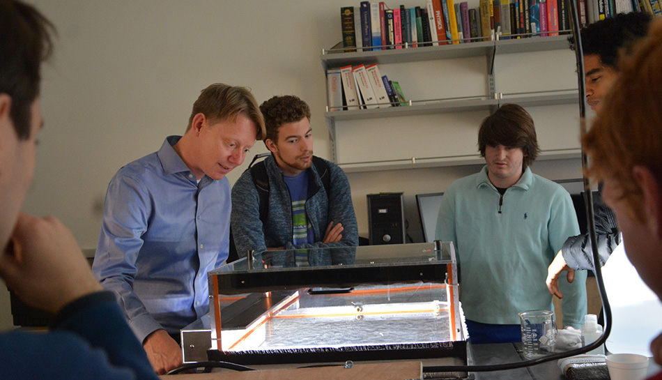 Dennis Bodewits, an assistant professor, shows students how a cloud chamber works during a hands-on demonstration.