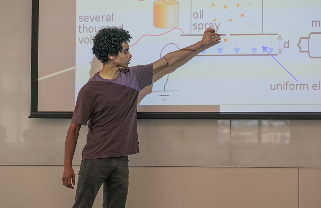Michael Robbins, a graduate student, shares information about Millikan's oil-drop experiment.