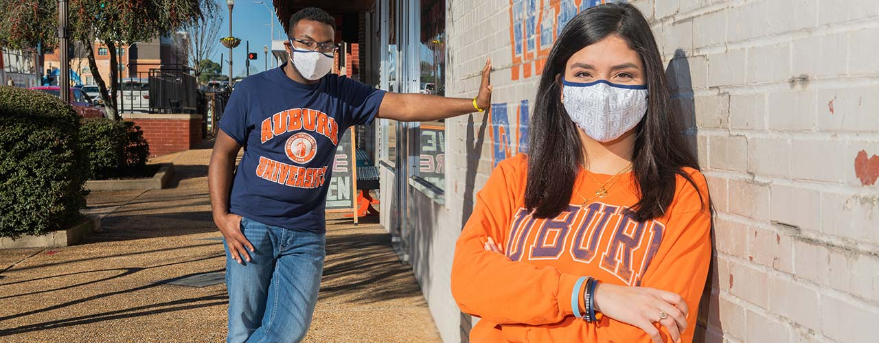 Two Auburn students in blue and orange sweaters