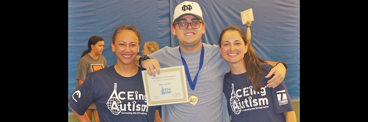 Dr. Melissa Pangelinan and Dr. Loriane Favoretto (Ph.D. from Auburn University, 2019) celebrate the end of the summer Auburn University ACEing Autism adapted tennis program with a participant!