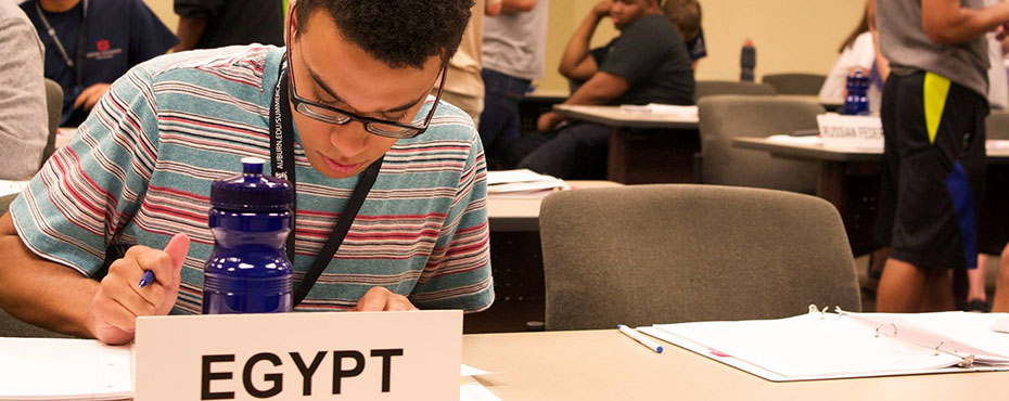 A student, who is assigned Egypt, works individually during class time preparing for the next session